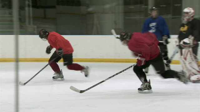 ms pan group of people practicing ice hockey / rutland, vermont, usa - practicing stock videos & royalty-free footage