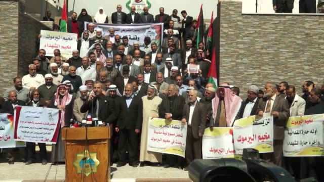 A group of people protest against the Yarmouk Refugee Camp clashes and demand the protection of Palestinian refugees in front of the Palestinian...
