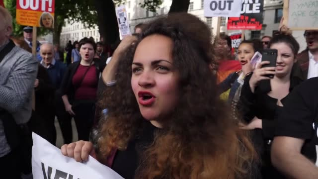 A group of people protest British Prime Minister Theresa May and calls for May to resign after gamble to call a snap general election failed to pay...