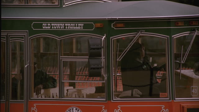 ms group of people riding the old town trolley / washington d.c., united states - trolleybus stock-videos und b-roll-filmmaterial