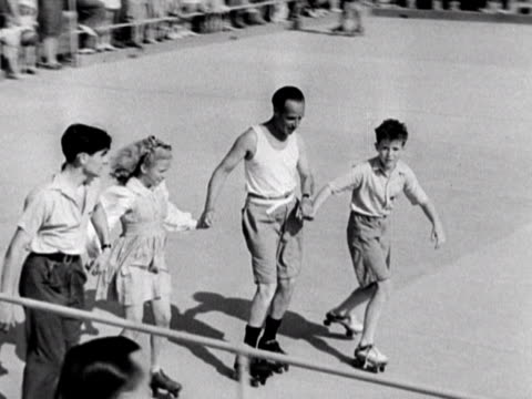 A group of people roller skate around a rink at the Coronation holiday camp on Hayling Island 1948