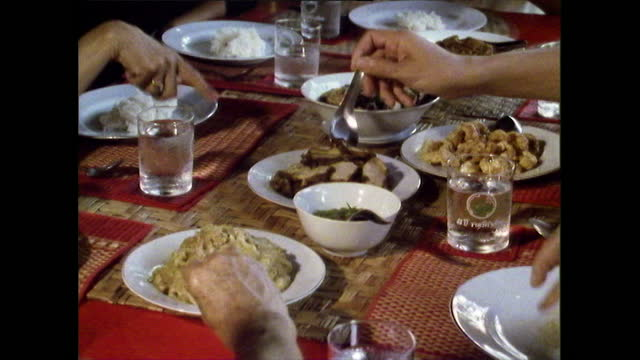 group of people share a meal in chiang mai, thailand; 1989 - thai food stock videos & royalty-free footage