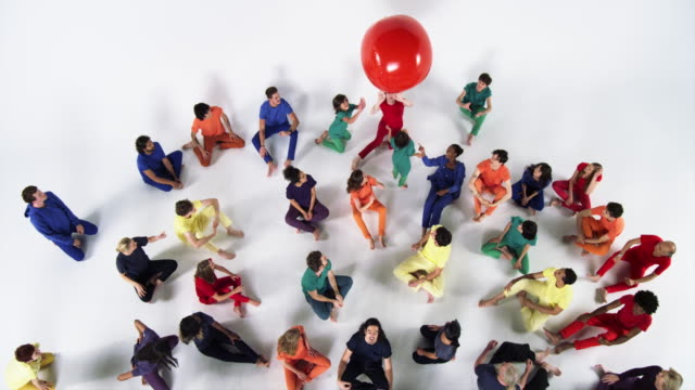 group of people sitting down and bouncing a red ball - sitting on floor stock videos and b-roll footage