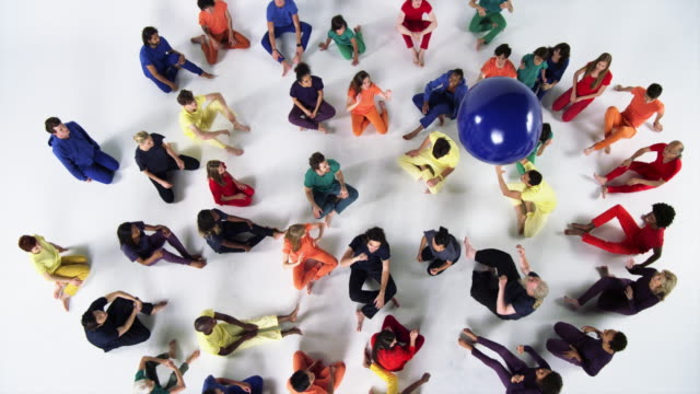 group of people sitting down and bouncing  red and blue balls - ball stock videos and b-roll footage