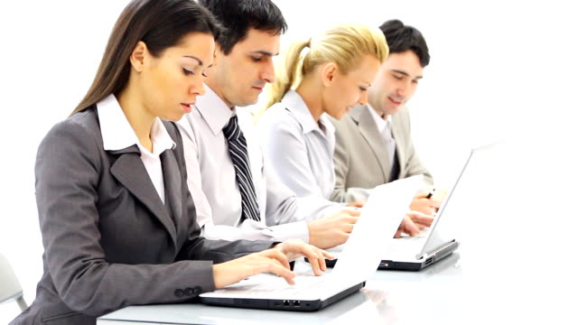 group of people sitting in row, working at laptops. - laptops in a row stock videos & royalty-free footage