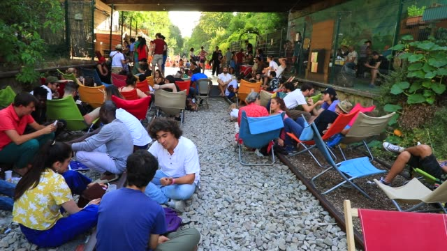 group of people sitting on the floor during a sunny summer afternoon at the paris former small belt railway on july 19, 2020 in paris, france. left... - group of people stock videos & royalty-free footage