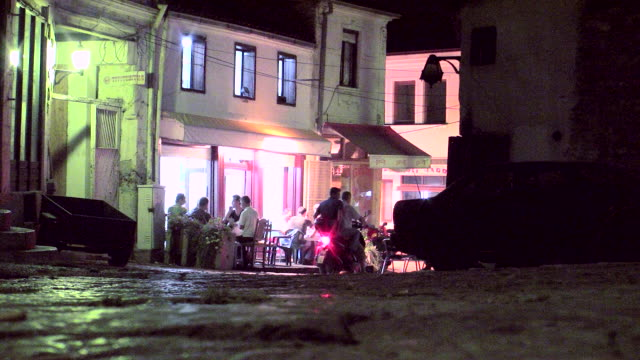 ws group of people sitting outside cafe / skopje, macedonia  - skopje stock videos and b-roll footage