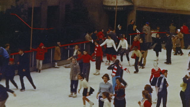 1966 ha ws group of people skating on ice rink / manhattan, new york - the past stock videos & royalty-free footage