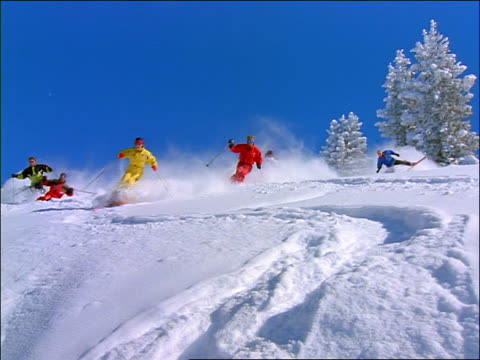group of people skiing down slope towards camera - real time stock videos & royalty-free footage