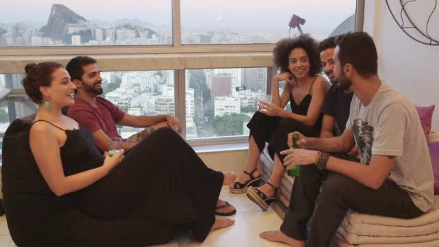 vídeos y material grabado en eventos de stock de ms a group of people socialising in an apartment  / rio de janeiro, brazil - pardo brasileño
