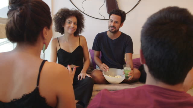 ms a group of people socialising in an apartment  / rio de janeiro, brazil - pardo brazilian stock videos & royalty-free footage