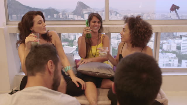 MS A group of people socialising in an apartment  / Rio de Janeiro, Brazil