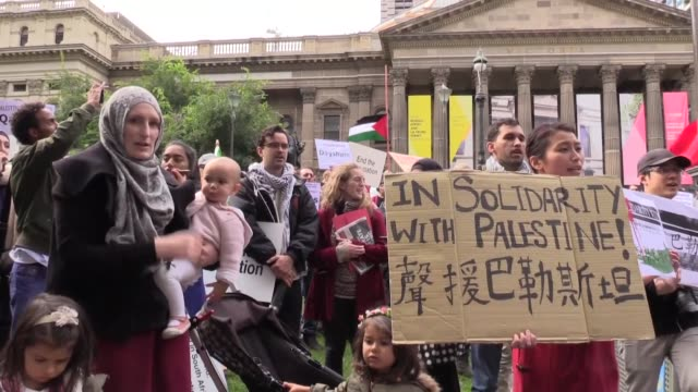 a group of people staged a demonstration in the australian city of melbourne to protest the massacre of palestinians by israeli armed forces near the... - ethnicity stock videos & royalty-free footage