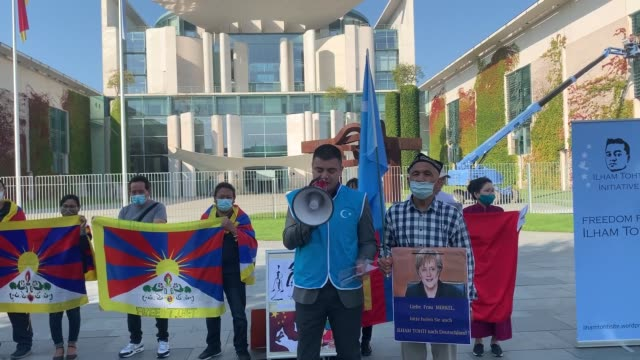 group of people staged a protest in the german capital berlin on september 14, 2020 against china's human rights abuses in xinjiang, hong kong, and... - tibet autonomous region stock videos & royalty-free footage
