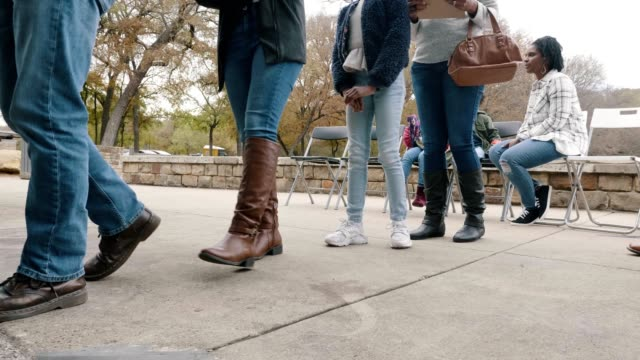 group of people stand in line at free outdoor clinic - social services stock videos & royalty-free footage