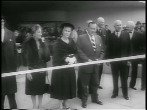 group of people standing by ribbon for dedication of guggenheim museum / nyc / newsreel - kunstmuseum stock-videos und b-roll-filmmaterial