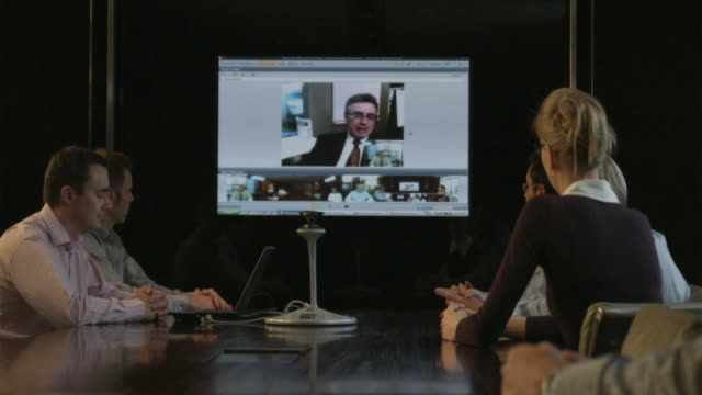 MS Group of people taking part in video conference, Sydney, Australia