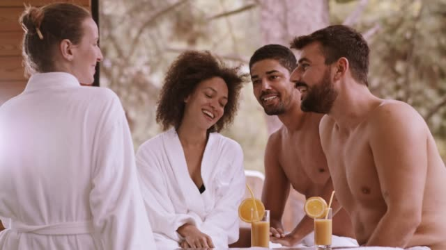 group of people talking at spa - bathrobe stock videos & royalty-free footage