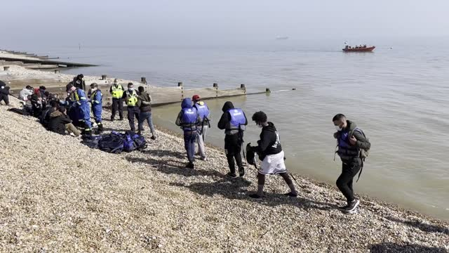 group of people thought to be migrants are escorted to shore in kingsdown, kent, after being intercepted by an rnli crew following a small boat... - social issues stock videos & royalty-free footage