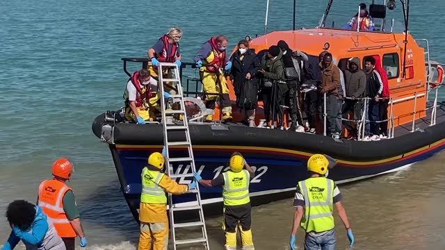 group of people thought to be migrants are escorted to shore in dungeness, kent, after being intercepted by an rnli crew following a small boat... - social issues stock videos & royalty-free footage