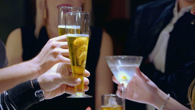 stockvideo's en b-roll-footage met cu group of people toasting drinks - martiniglas