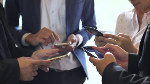 group of people using phone social media, close-up - social gathering stock videos & royalty-free footage