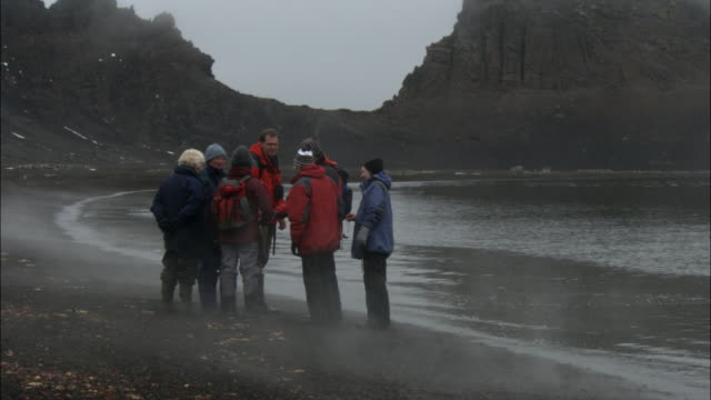 ms, group of people walking along coastline, deception island, antarctica - antarctic ocean stock videos and b-roll footage