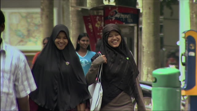 ms group of people walking on street / malaysia - modest clothing stock videos & royalty-free footage