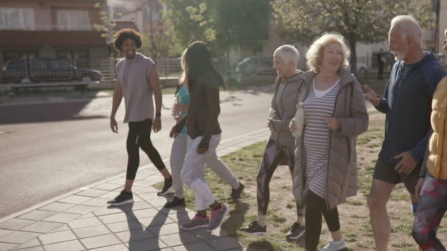 group of people walking together and talking after their dance class - active lifestyle stock videos & royalty-free footage