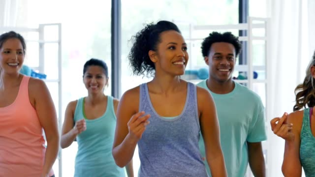 Group of people warm up before aerobics class