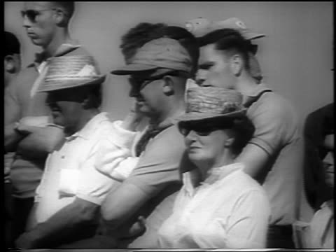 vidéos et rushes de b/w 1962 group of people with sunglasses hats standing outdoors at doralryder open / newsreel - casquette de baseball