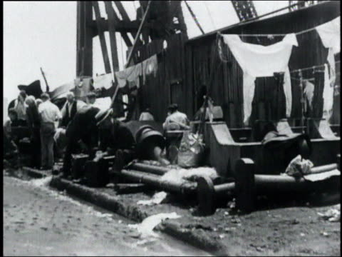 group of people working in a hooverville shantytown / usa - 1932 stock videos & royalty-free footage
