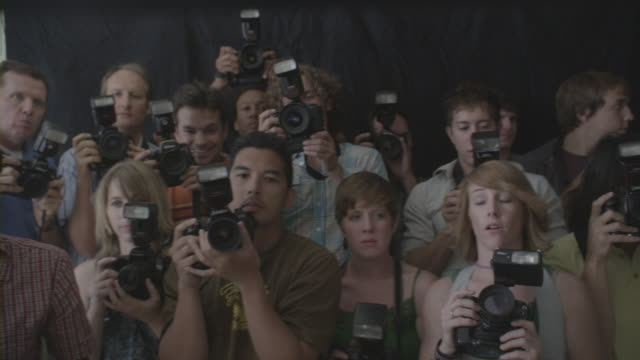 Group of photographers clicking pictures.