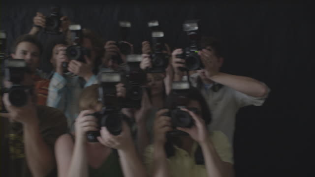 group of photographers clicking pictures. - flash stock videos & royalty-free footage