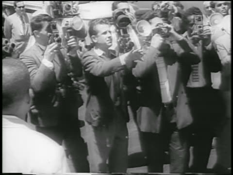 group of photographers taking photos of richard + pat nixon / venezuela - 1958 stock-videos und b-roll-filmmaterial