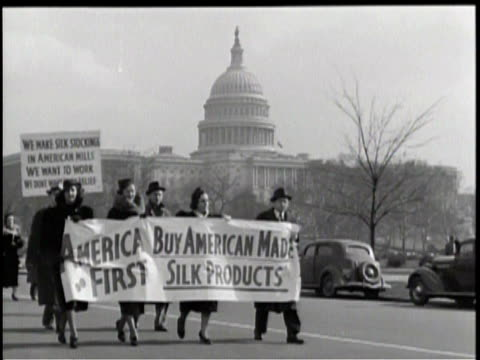 a group of picketers boycott the import of japanese silks in america / a woman addresses the camera explaining their reasons for the silk boycott / a... - 1938年点の映像素材/bロール