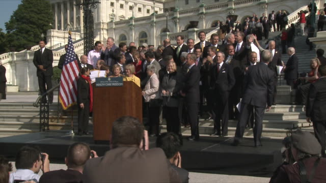 group of politicians standing by capitol building during political rally against health care legislation on november 5th 2009 / capitol hill... - building feature stock videos & royalty-free footage