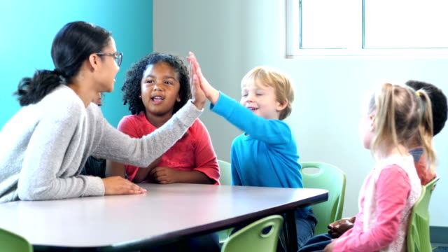 group of preschoolers, boys gets high-five from teacher - preschool student stock videos and b-roll footage