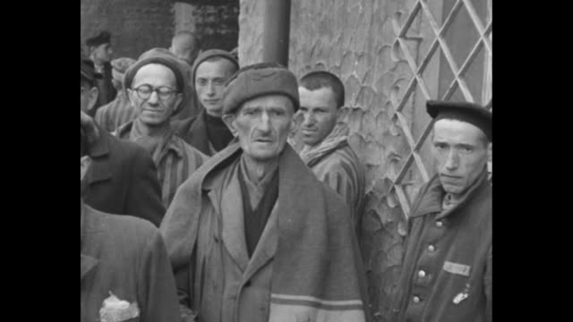 group of prisoners walking past camera / closer view of prisoners / pan across prisoners posing for photo opportunity / close view of prisoner... - concentration camp stock videos and b-roll footage