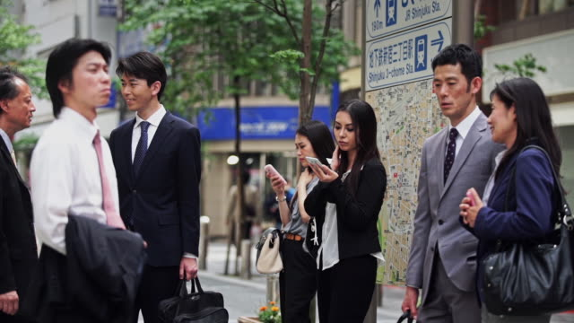 group of professionals waiting in shinjuku street - medium group of people stock videos & royalty-free footage