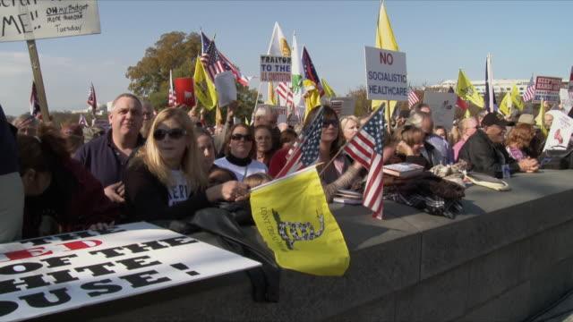 vídeos de stock e filmes b-roll de group of protesters at political rally against health care legislation on november 5th, 2009 / capitol hill, washington dc, usa / audio - 2009
