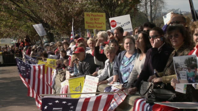 vídeos y material grabado en eventos de stock de group of protesters at political rally against health care legislation on november 5th, 2009 / capitol hill, washington dc, usa / audio - 2009