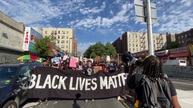 group of protesters gathered in new york on july 20, 2020 as part of black lives matter movement, which gained momentum in the wake of the killing of... - banner stock videos & royalty-free footage