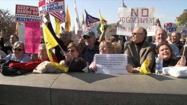 vídeos de stock e filmes b-roll de group of protesters shouting at political rally against health care legislation on november 5th, 2009 / capitol hill, washington dc, usa / audio - 2009