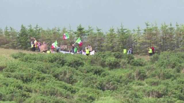 a group of protesters wave mexican flags on the hillside above the trump international golf links minutes before presumptive republican presidential... - links golf stock videos & royalty-free footage