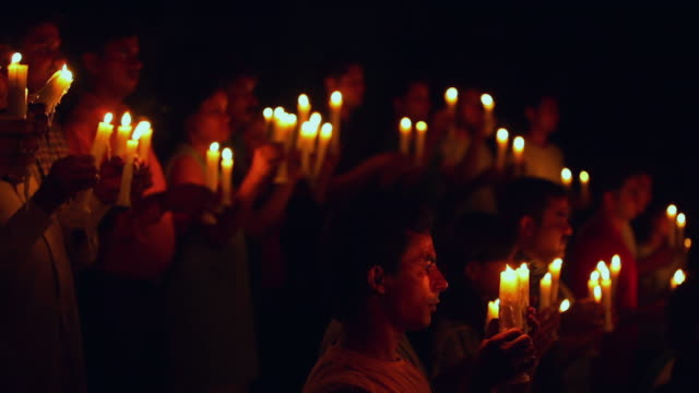 group of protestors holding candles, delhi, india - protestor stock videos & royalty-free footage