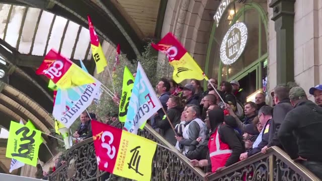 A group of railway workers march through Paris Gare de Lyon in protest after voting to continue ongoing rail strikes during a general assembly Monday...