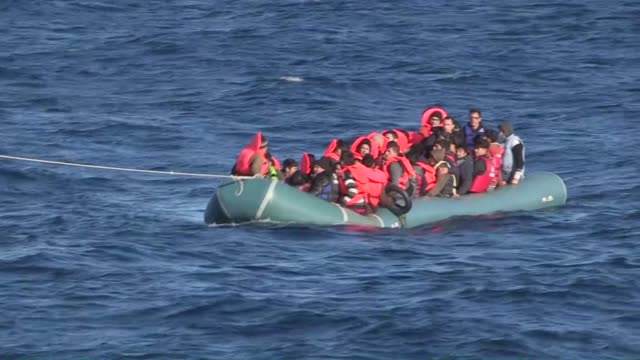 a group of refugees on their inflatable boat which is in danger of sinking are being rescued by the crews as the turkish coast guard search and... - 2015 stock-videos und b-roll-filmmaterial