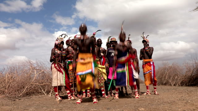 Group of Rendille men performing a traditional dance