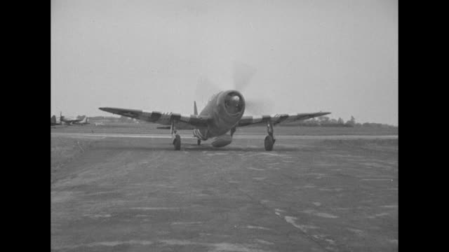 a group of republic p47 thunderbolts circles and one taxis past camera / lt col francis gabreski waves to members of ground crew felix schacki and... - hakenkreuz stock-videos und b-roll-filmmaterial